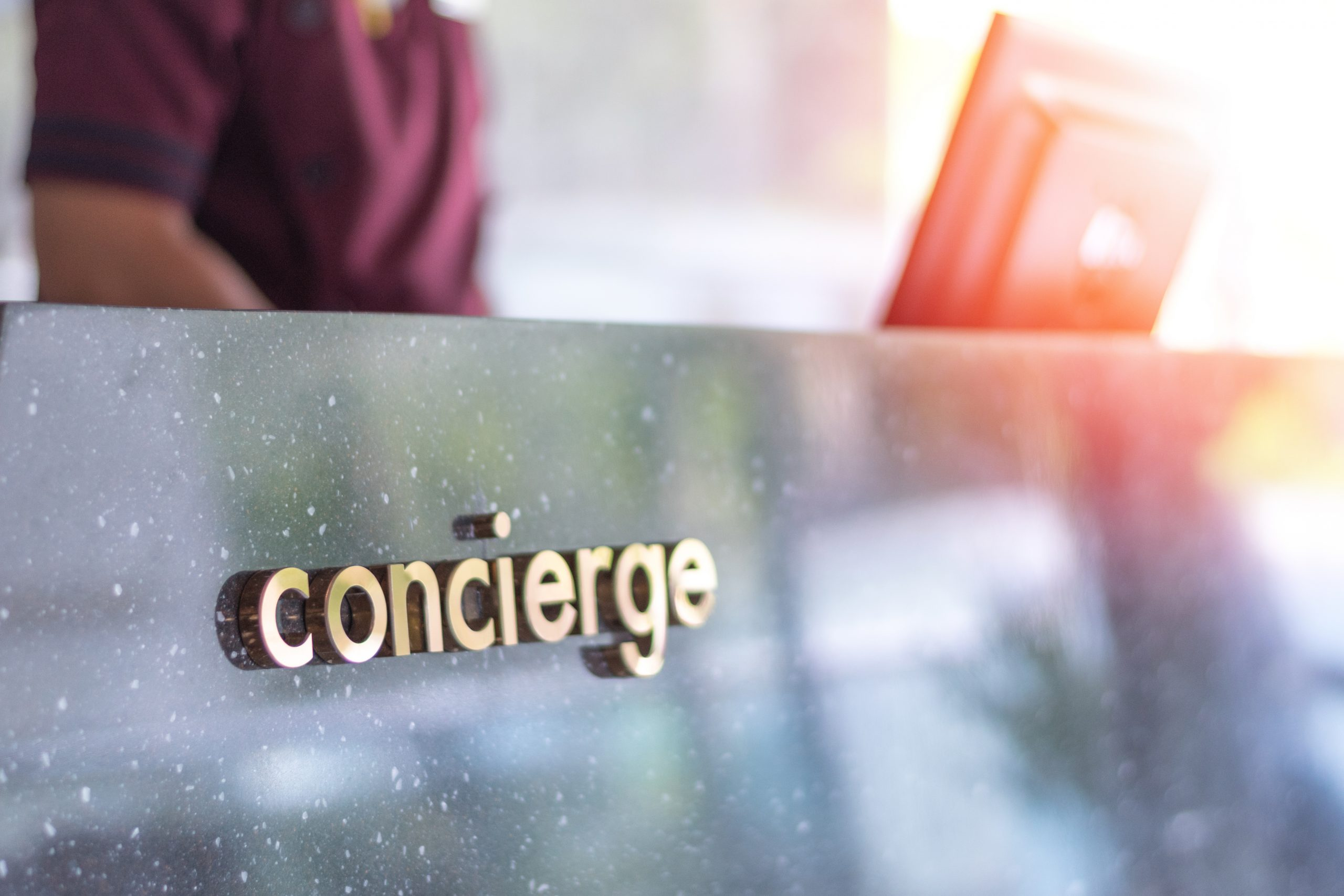 Concierge,Service,Desk,Counter,With,Staff,Team,Working,In,Front